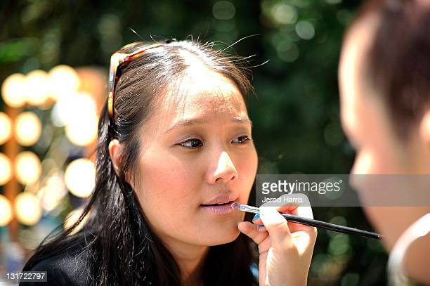 A guest gets her makeup done by a professional makeup artist from Stila at the Alison Brod Public Relations Los Angeles Summer Style Event on June 15...