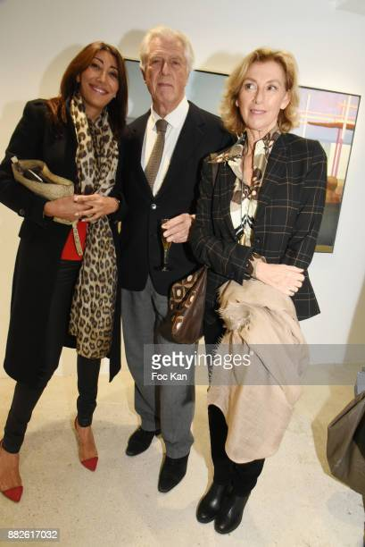 A guest Gilles Hertzog and his ex wife Anna Herzog attend the Tribute to Leonardo Cremonini Exibition Preview at Galerie T Lon November 29 2017 in...