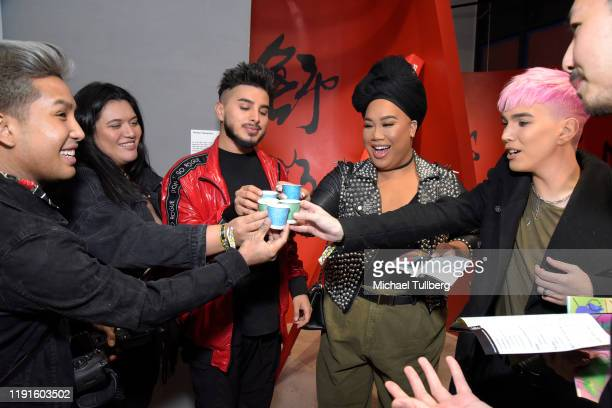 Guest guest Fabian Quinonez YouTube personality Patrick Starrr and Zachary Edward attend the VIP opening night for the Dumpling Associates popup art...