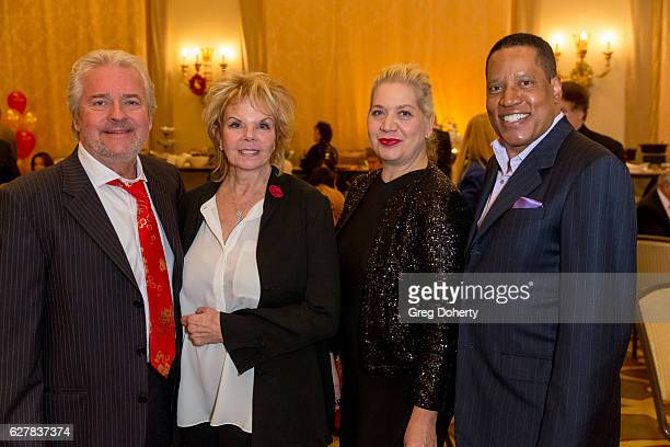 Guest Guest Nina Perry and Lawyer writer and radio and television personality Larry Elder attend The Thalians Presidents Club's Holiday Brunch...