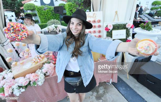 Guest holding sweet treats at beGlammed Sunset Soiree Presented by Fullscreen on April 12 2019 in Palm Springs California