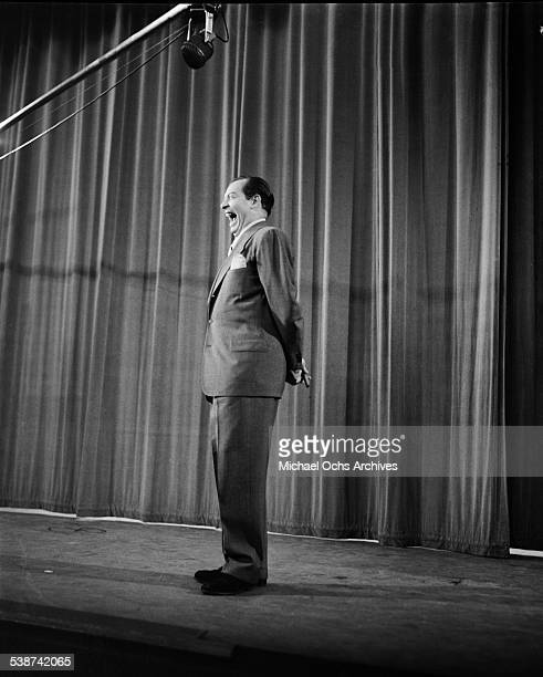 """Guest hosts and comedian Milton Berle practices his monologue during rehearsals for """"The Toast of the Town"""" hosted by Ed Sullivan in New York,New..."""