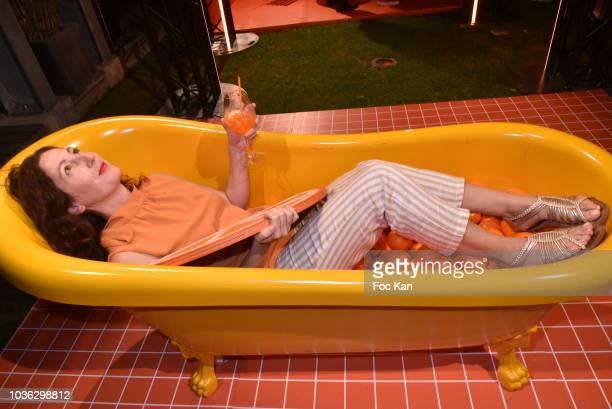 A guest in a bathtub poses for a selfie underneath a ceiling camera during the Spritz Plazza Party at the 118 Warner on September 19 2018 in Paris...