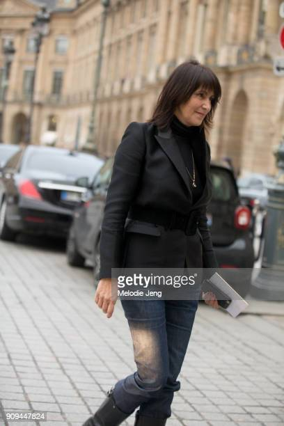 A guest in a black blazer and blue jeans outside the Ulyana Sergeenko show at Place Vendome on January 23 2018 in Paris France