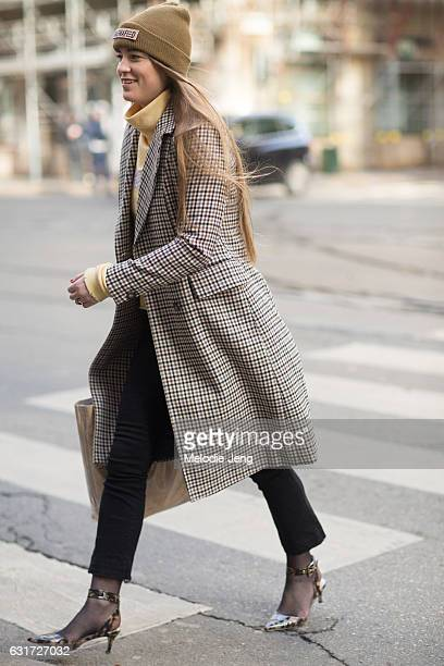 Guest in a check pattern jacket and Magnafield hat during Milan Men's Fashion Week Fall/Winter 2017/18 on January 14, 2017 in Milan, Italy.