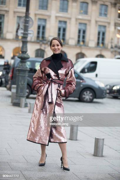 A guest in a pink metallic jacket outside the Ulyana Sergeenko show at Place Vendome on January 23 2018 in Paris France