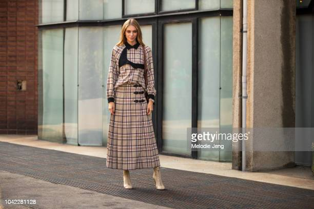 A guest in a plaid dress at Antonio Marras during Milan Fashion Week Spring/Summer 2019 on September 21 2018 in Milan Italy