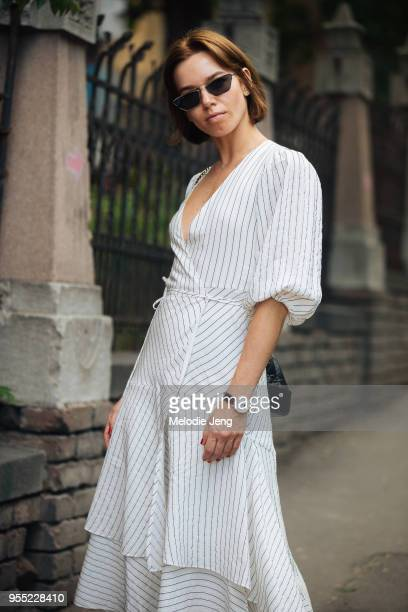 A guest in a white striped dress and white netted sneakers on May 5 2018 in Tbilisi Georgia
