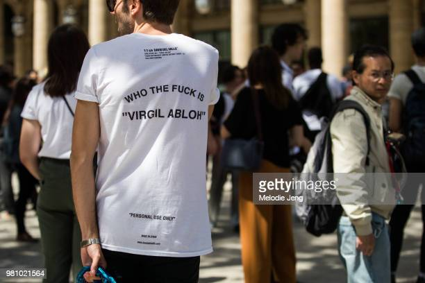 A guest in a 'Who the fuck is Virgil Abloh' tshirt during Paris Fashion Week Mens Spring/Summer 2019 on June 21 2018 in Paris France