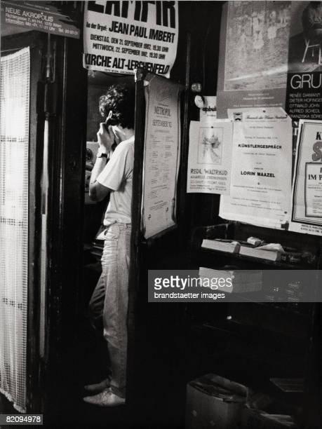 Guest in Cafe Hawelka taking in phone box Vienna Photograph Around 1982 [Telefonierender Gast in der Telefonzelle im Cafe Hawelka in Wien...