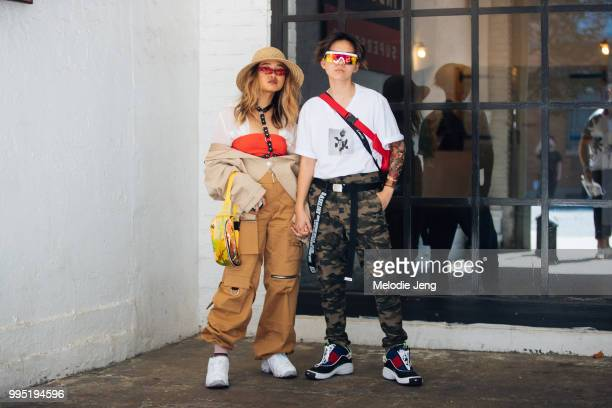 A guest in cargo pants a guest in a graphic white tshirt camo pants and Tommy Hilfiger sneakers during New York Fashion Week Mens Spring/Summer 2019...