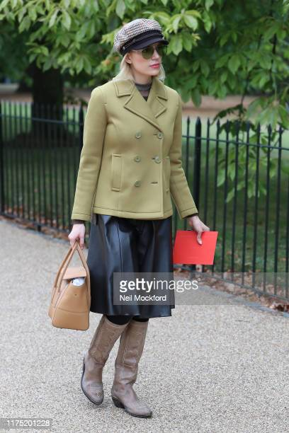 Guest in green coat arrives at Roksanda during London Fashion Week September 2019 on September 16, 2019 in London, England.