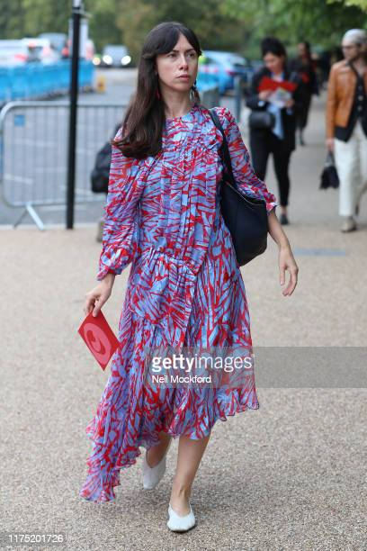 Guest in red and blue dress arrives at Roksanda during London Fashion Week September 2019 on September 16, 2019 in London, England.