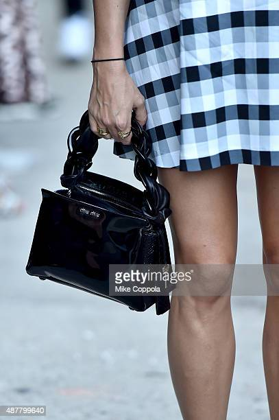 A guest in street style bag detail arrives at Spring 2016 New York Fashion Week The Shows at Skylight at Clarkson Sq on September 11 2015 in New York...