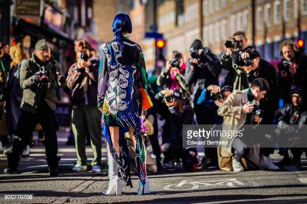 A guest is posing in front of street style photographers during London Fashion Week February 2018 on February 17 2018 in London England