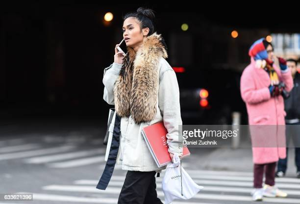 A guest is seen a gray coat and fur scarf outside of the STAMPD show during New York Fashion Week Men's AW17 on February 2 2017 in New York City