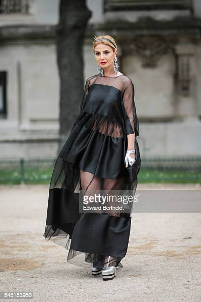 A guest is seen after the Chanel show during Paris Fashion Week Haute Couture F/W 2016/2017 on July 5 2016 in Paris France