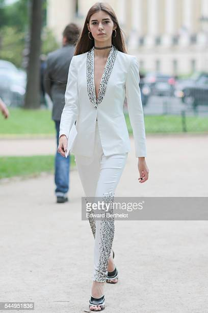 A guest is seen after the Giambattista Valli show during Paris Fashion Week Haute Couture F/W 2016/2017 on July 4 2016 in Paris France