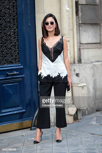 A guest is seen after the Valentino show during Paris Fashion Week Haute Couture F/W 2016/2017 on July 6 2016 in Paris France