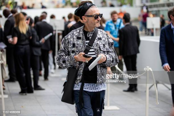 A guest is seen at Dior during Paris Fashion Week Menswear Spring/Summer 2020 on June 21 2019 in Paris France