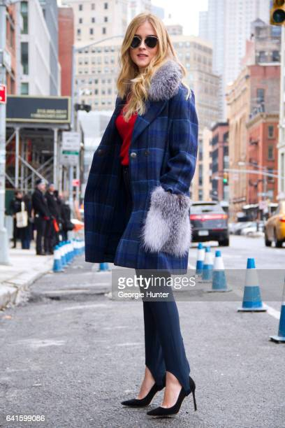 Guest is seen at Spring Studios outside the Lacoste show wearing blue tartan coat with fur pockets and collar black stilettos black leggings red top...