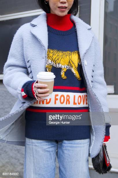 Guest is seen at Spring Studios outside the Phillip Lim show wearing pastel blue coat with oversized stitching denim jeans black leather and faux fur...