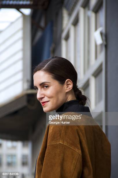 Guest is seen at Spring Studios outside the Phillip Lim show wearing tan suede bomber jacket with black large ribbed collar on February 13 2017 in...