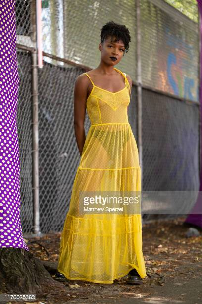 A guest is seen attending Afropunk Brooklyn wearing yellow sheer dress at Commodore Barry Park on August 24 2019 in New York City