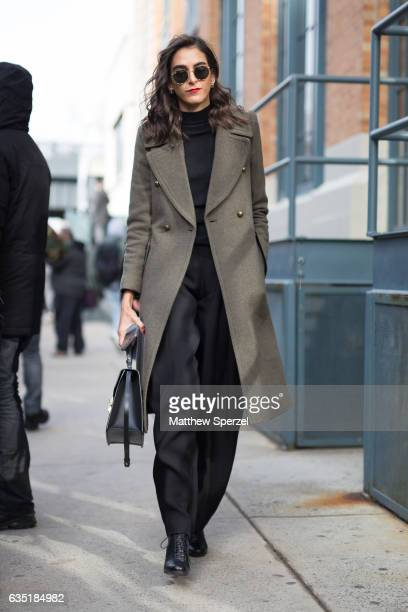 A guest is seen attending Carolina Herrera during New York Fashion Week wearing an olive wool coat with black outfit on February 13 2017 in New York...
