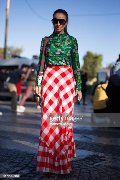 A guest is seen attending Chanel during Paris Fashion Week wearing Chanel on October 3 2017 in Paris France