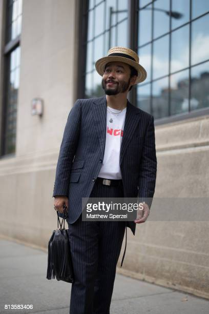 A guest is seen attending Deveaux at EN Japanese Brasserie during Men's New York Fashion Week wearing a Nigold suit on July 12 2017 in New York City