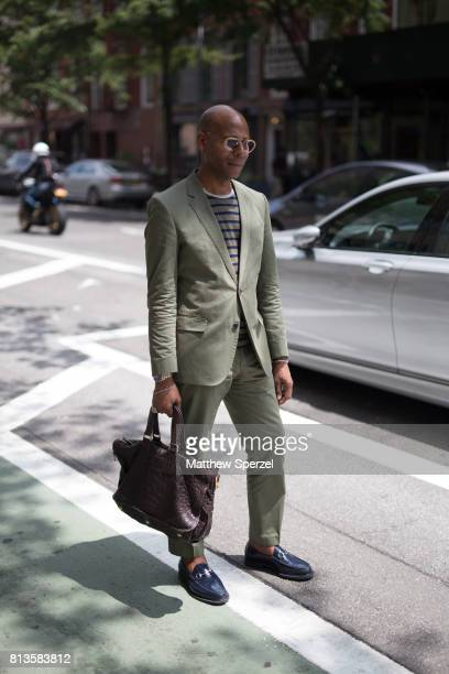 A guest is seen attending Deveaux at EN Japanese Brasserie during Men's New York Fashion Week wearing a faded olive suit on July 12 2017 in New York...