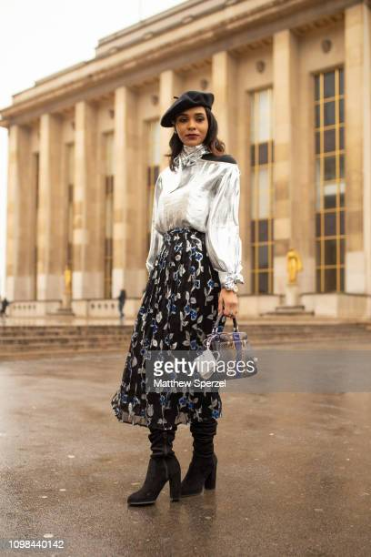 Guest is seen attending Elie Saab during Paris Haute Couture Fashion Week wearing silver shirt, black beret and skirt on January 23, 2019 in Paris,...