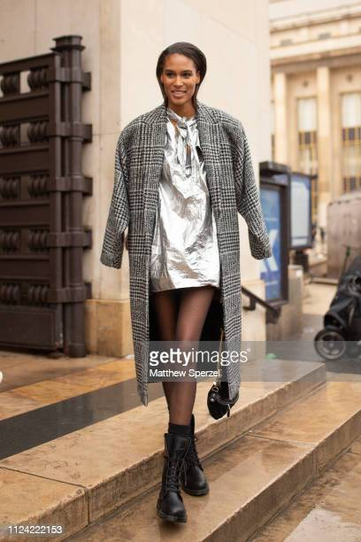 A guest is seen attending Elie Saab during Paris Haute Couture Fashion Week wearing grey plaid wool coat silver metallic dress and black boots on...