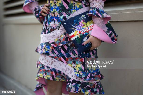 A guest is seen attending Hakan Akkaya during New York Fashion Week wearing a multicolored dress on September 11 2017 in New York City