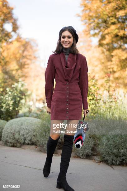 A guest is seen attending Issey Miyake during Paris Fashion Week wearing a maroon dress on September 29 2017 in Paris France