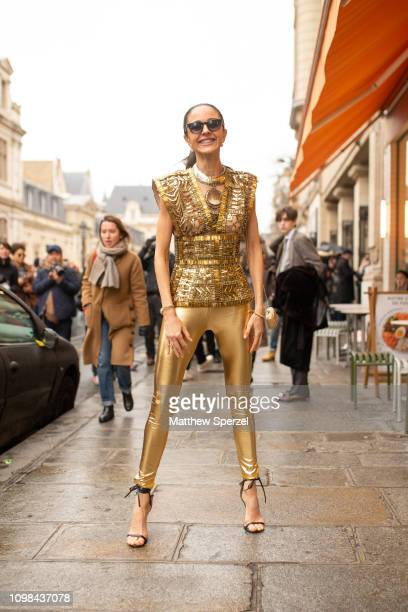 A guest is seen attending Jean Paul Gaultier during Paris Haute Couture Fashion Week wearing gold Jean Paul Gaultier outfit on January 23 2019 in...