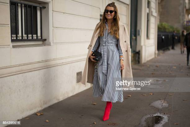 Guest is seen attending JOUR/N during Paris Fashion Week wearing a black and white striped dress with red boots on September 26, 2017 in Paris,...