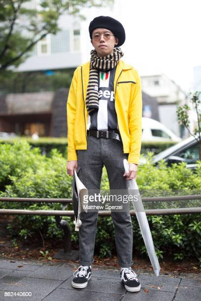 A guest is seen attending KEISUKEYOSHIDA during Tokyo Fashion Week wearing a yellow jacket with grey pants and beret on October 17 2017 in Tokyo Japan