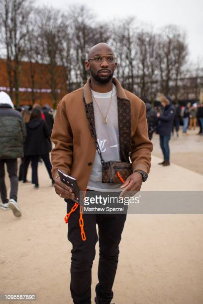 A guest is seen attending Louis Vuitton during Men's Paris Fashion Week AW19 wearing Louis Vuitton jacket and bag on January 17 2019 in Paris France