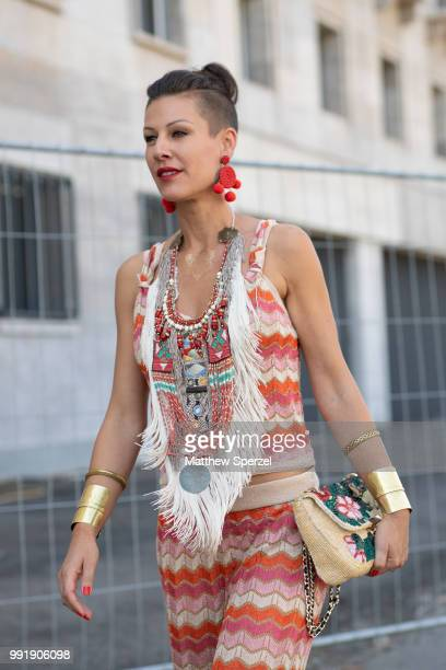 A guest is seen attending MAISON COMMON wearing a pastel wavystripe outfit during the Berlin Fashion Week July 2018 on July 4 2018 in Berlin Germany