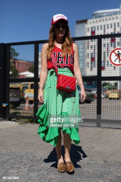 A guest is seen attending Maison Common wearing a red jersey and green skirt during the Berlin Fashion Week July 2018 on July 4 2018 in Berlin Germany