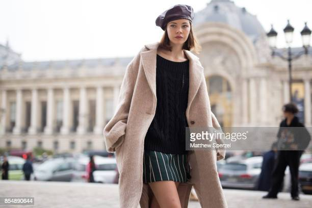 A guest is seen attending Maison Margiela during Paris Fashion Week wearing a camel coat with black sweater and beret on September 27 2017 in Paris...