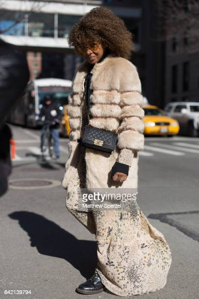 A guest is seen attending MARC JACOBS during New York Fashion Week wearing a taupe fur coat with floral skirt on February 16 2017 in New York City