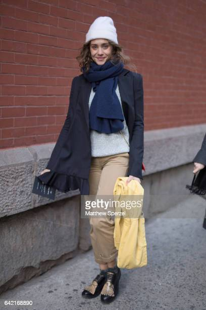 A guest is seen attending Marc Jacobs during New York Fashion Week wearing a navy blazer with navy scarf and white hat on February 16 2017 in New...