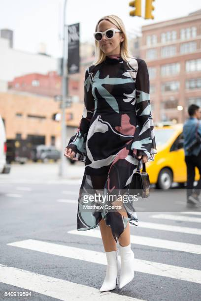 A guest is seen attending Marchesa during New York Fashion Week wearing an artistic pattern dress on September 13 2017 in New York City