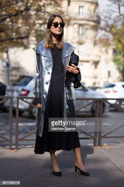 A guest is seen attending Miu Miu during Paris Fashion Week wearing Miu Miu on October 3 2017 in Paris France