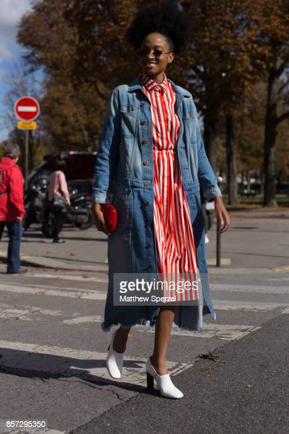 A guest is seen attending Moncler Gamme Rouge during Paris Fashion Week wearing Moncler on October 3 2017 in Paris France