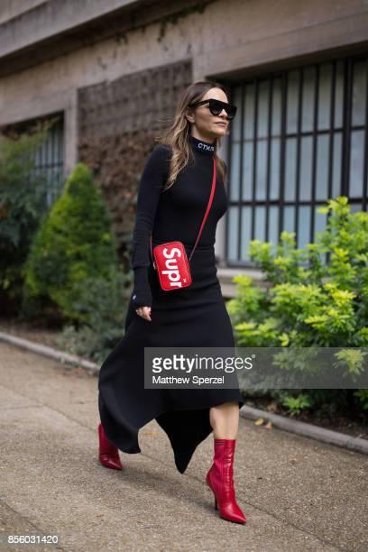 A guest is seen attending Mugler during Paris Fashion Week wearing Mugler on September 30 2017 in Paris France