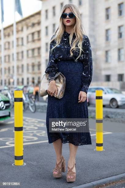 A guest is seen attending Riani wearing a navy outfit with heels during the Berlin Fashion Week July 2018 on July 4 2018 in Berlin Germany